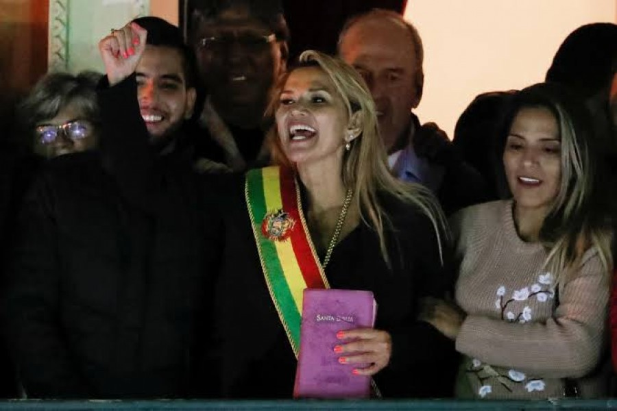 Bolivian senator Jeanine Anez gestures after she declared herself as Interim President of Bolivia, at the balcony of the Presidential Palace, in La Paz, Bolivia November 12, 2019. REUTERS/Carlos Garcia Rawlins