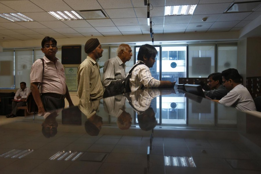 People line to submit their papers inside the Income Tax office in New Delhi, April 5, 2013. Reuters/Files