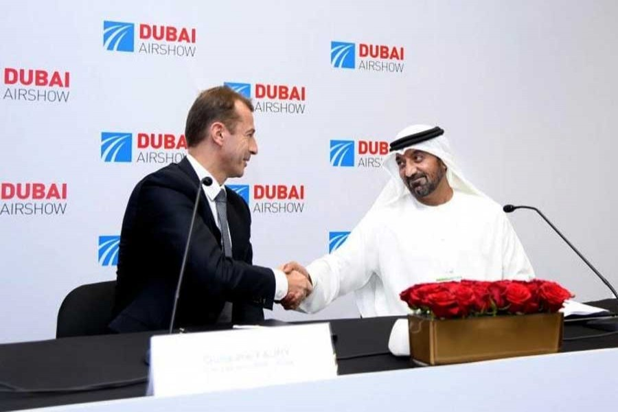 Sheikh Ahmed bin Saeed Al Maktoum, Emirates Chairman and Chief Executive and Guillaume Faury, Airbus Chief Executive Officer seen at the signing ceremony