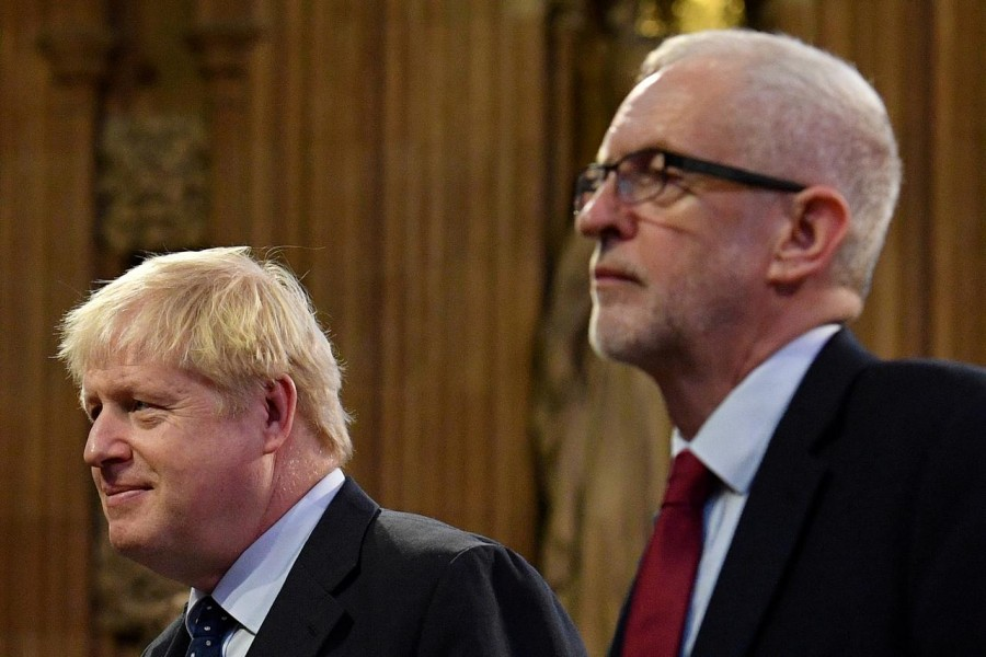 Britain's prime minister Boris Johnson and main opposition Labour Party leader Jeremy Corbyn head the procession of members of parliament through the Central Lobby toward the House of Lords to listen to the Queen's Speech during the State Opening of Parliament in the Houses of Parliament in London, Britain, October 14, 2019. Reuters/Files
