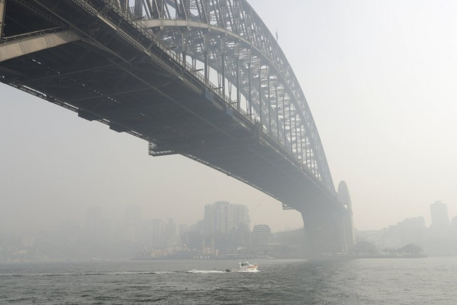 Smoke haze hangs over the Sydney Harbour Bridge in Sydney, on Thursday, Nov 21 - AP Photo/Rick Rycroft