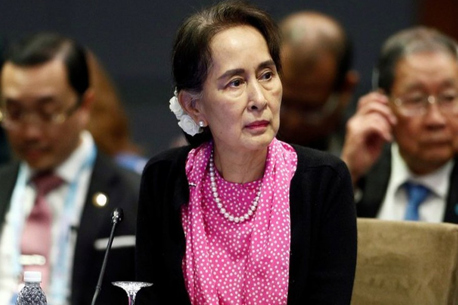 Noble laureates want Suu Kyi, generals held criminally accountable for genocide