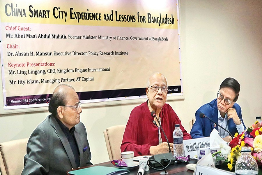 Former Finance Minister A M A Muhith (centre) speaking at a seminar on 'China Smart City Experience and Lessons for Bangladesh' at the conference room of PRI in the city on Wednesday. PRI Chairman Dr Zaidi Sattar (left) and PRI Executive Director Dr Ahsan H Mansur (right) also spoke at the seminar — FE photo