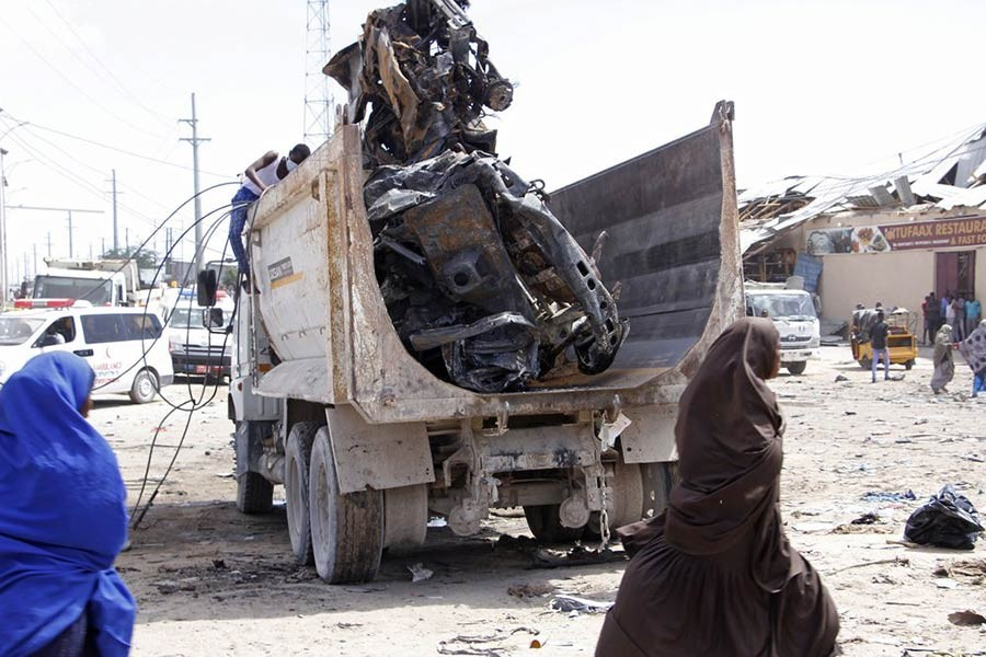A truck carrying wreckage of a car used in a car bomb in Somalia on Saturday. -AP Photo