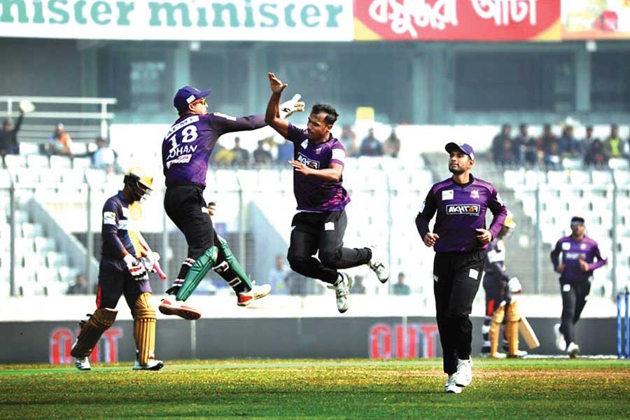 Chattogram Challengers' Rubel Hossain celebrating with teammate Nurul Hasan Sohan after getting the wicket of Dhaka Platoon's Tamim Iqbal during the BBPL match at Sher-e-Bangla National Cricket Stadium in the city on Monday	— BCB