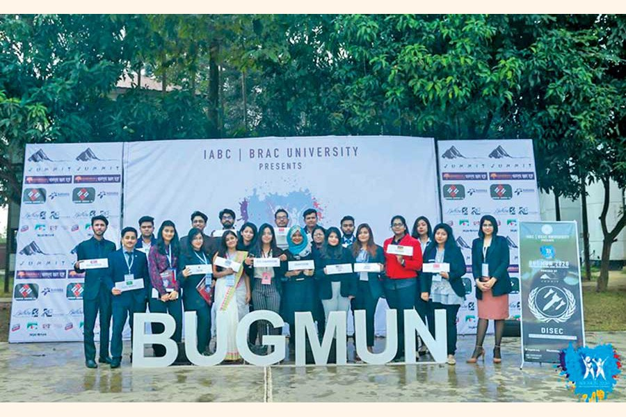 "Members of the committee ""DISEC"" pose for a photo at Brac University Global Model United Nations"