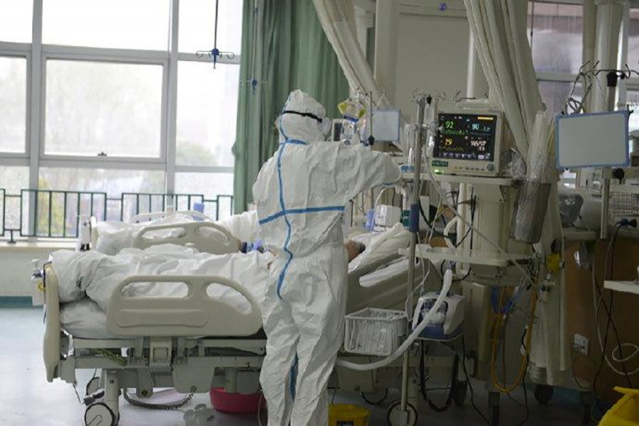 A picture released by the Central Hospital of Wuhan shows medical staff attending to patient at the The Central Hospital Of Wuhan Via Weibo in Wuhan, China on an unknown date — THE CENTRAL HOSPITAL OF WUHAN VIA WEIBO/Handout via REUTERS