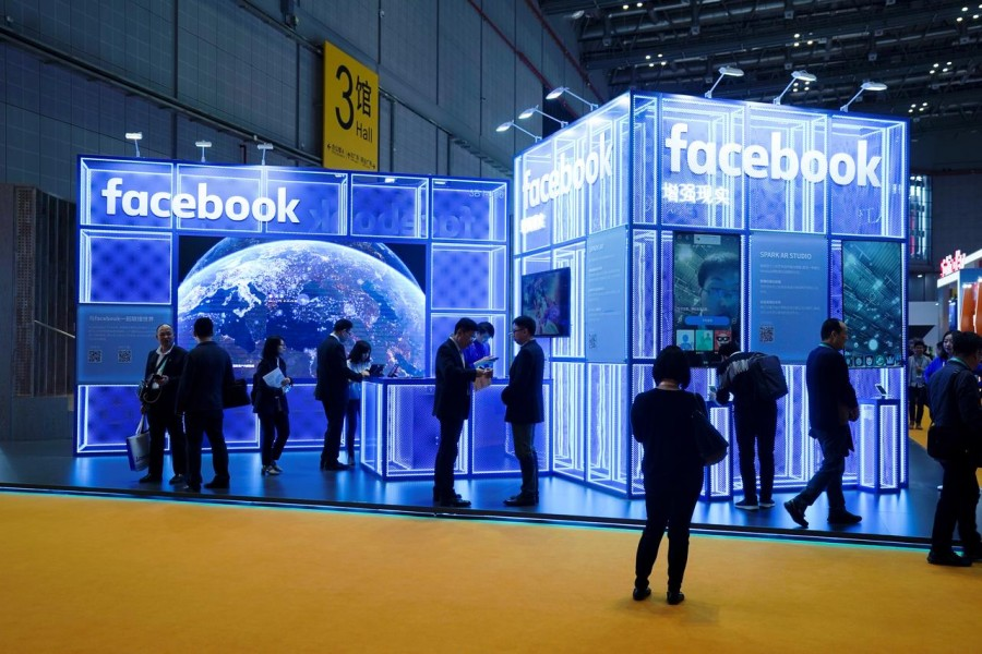 FILE PHOTO: Facebook signs are seen during the China International Import Expo (CIIE), at the National Exhibition and Convention Center in Shanghai, China November 5, 2018. REUTERS/Aly Song