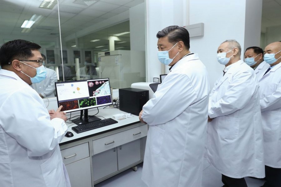 Chinese President Xi Jinping, also general secretary of the Communist Party of China Central Committee and chairman of the Central Military Commission, learns about the progress on the COVID-19 vaccine and anti-body during his visit to the Academy of Military Medical Sciences in Beijing, March 02, 2020.     — Photo: Xinhua