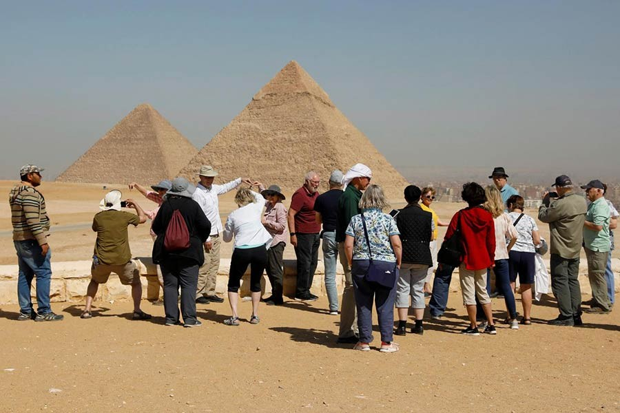 Tourists gather at the Great Pyramids of Giza, on the outskirts of Cairo, Egypt. -Reuters file photo