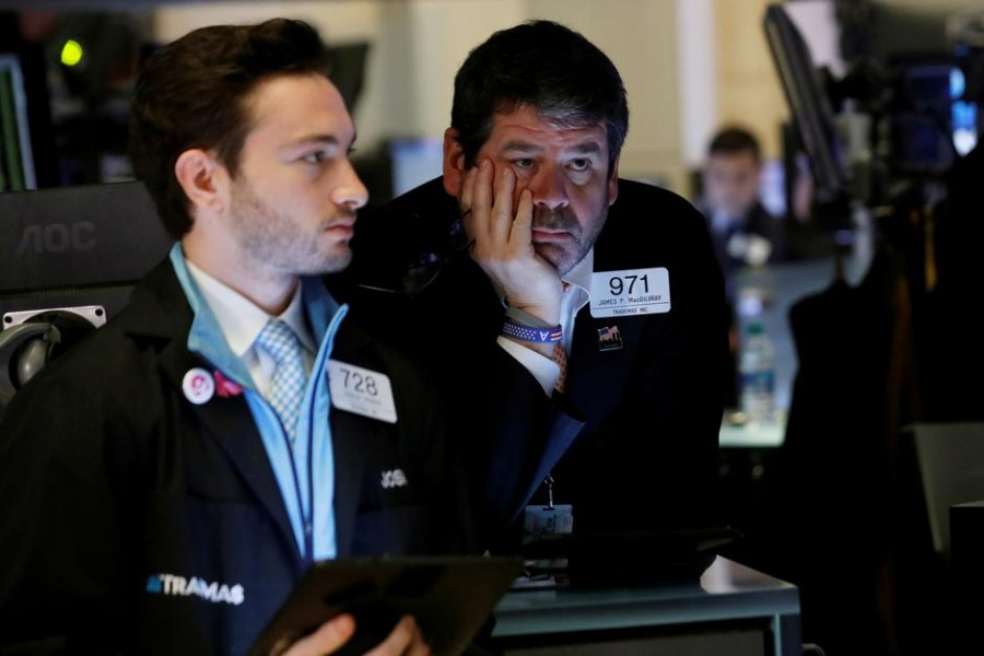 Traders work on the floor of the New York Stock Exchange (NYSE) in New York, US on March 12, 2020.  —Photo: Reuters