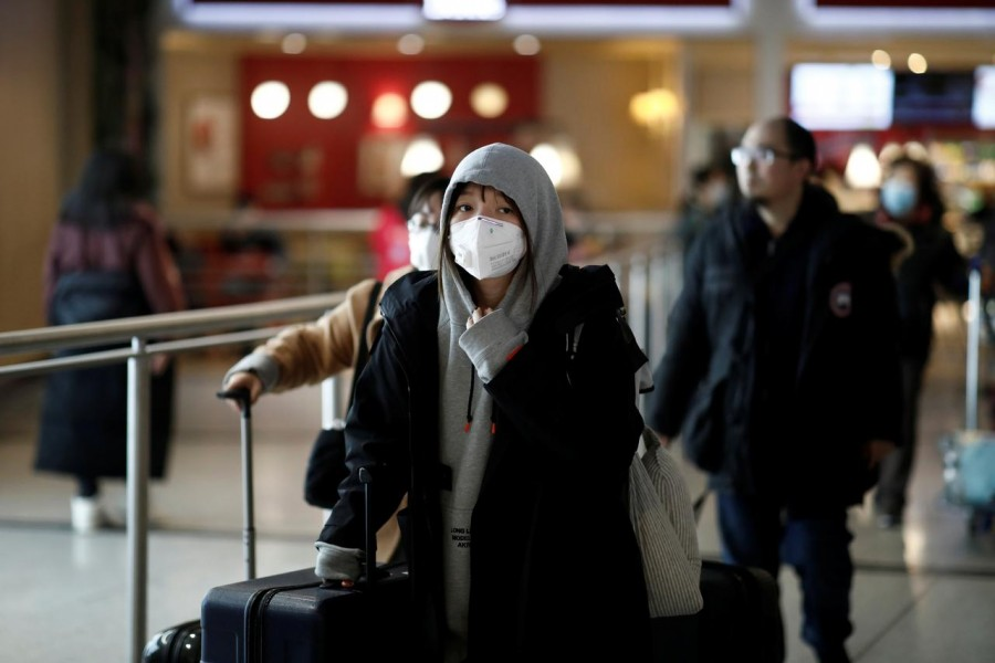 Tourists from an Air China flight from Beijing wear protective masks as they arrive at Charles de Gaulle airport in Paris, France, January 26, 2020. — Reuters/Files
