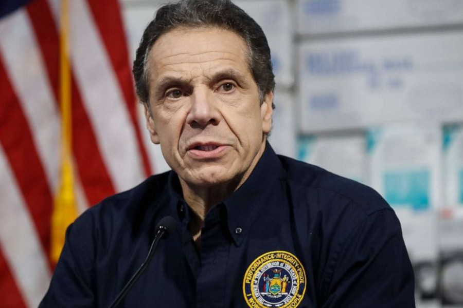 New York Gov. Andrew Cuomo speaks during a news conference against a backdrop of medical supplies at the Jacob Javits Center that will house a temporary hospital in response to the COVID-19 outbreak, March 24, 2020, in New York. John Minchillo/AP