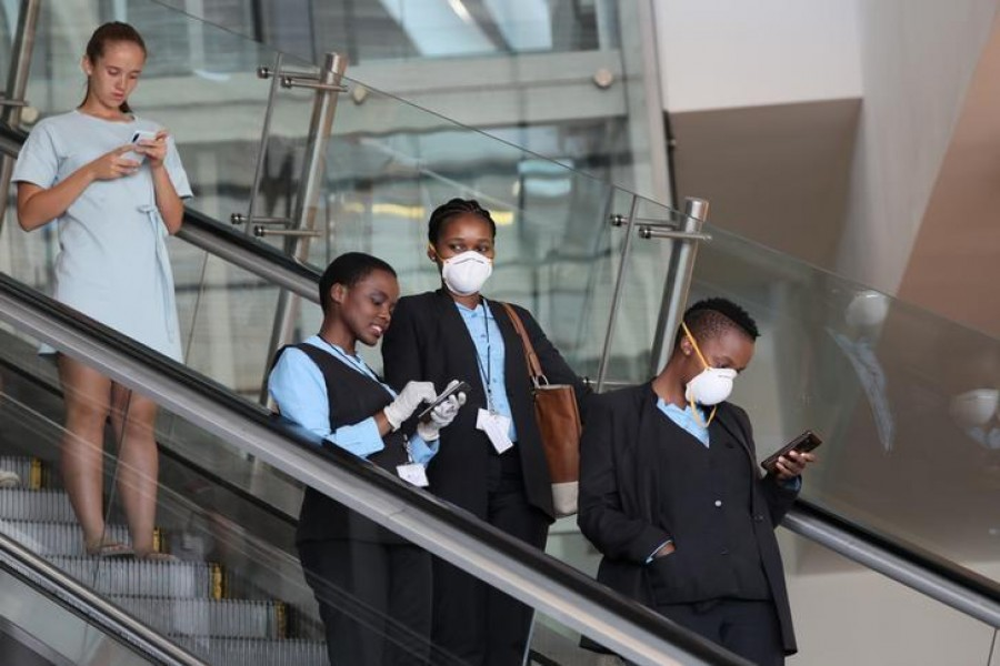 Top News March 23, 2020 / 6:16 PM / 4 days ago South Africa's confirmed coronavirus cases jump by 128 to 402  1 Min Read  Airport staff wear protective masks at Cape Town International Airport, amid the coronavirus outbreak, in Cape Town, South Africa, March 18, 2020. REUTERS/Sumaya Hisham