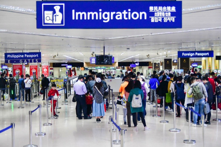 China bars foreign visitors as imported cases rise
