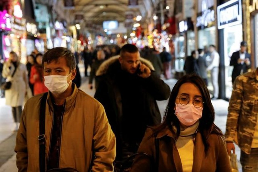 People wear protective face masks due to coronavirus concerns in Istanbul, Turkey March 16, 2020. REUTERS/Umit Bektas