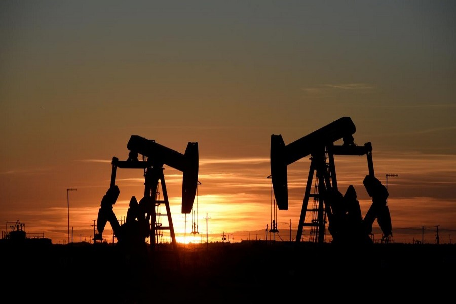 Representational image: Pump jacks operate at sunset in an oilfield in Midland, Texas U.S. August 22, 2018. — Reuters/Files