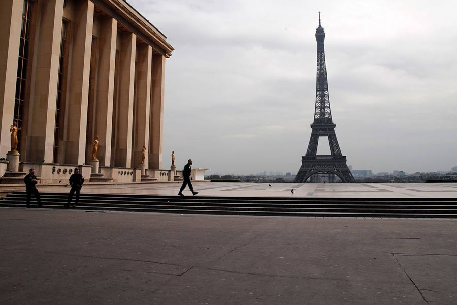 Police officers patrolling the empty Trocadero plaza next to the Eiffel Tower in Paris on March 17 –AP Photo