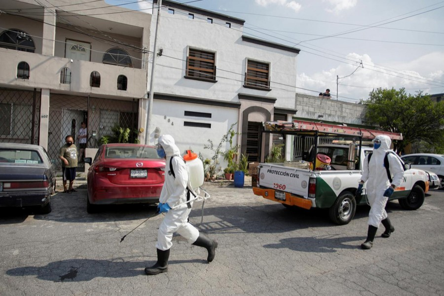 """Municipal workers sanitise the surroundings of the nursing house """"Retirement House Luis Elizondo"""", where people have been infected by the coronavirus disease (COVID-19), in Guadalupe, on the outskirts of Monterrey, Mexico May on 6, 2020 — Reuters photo"""