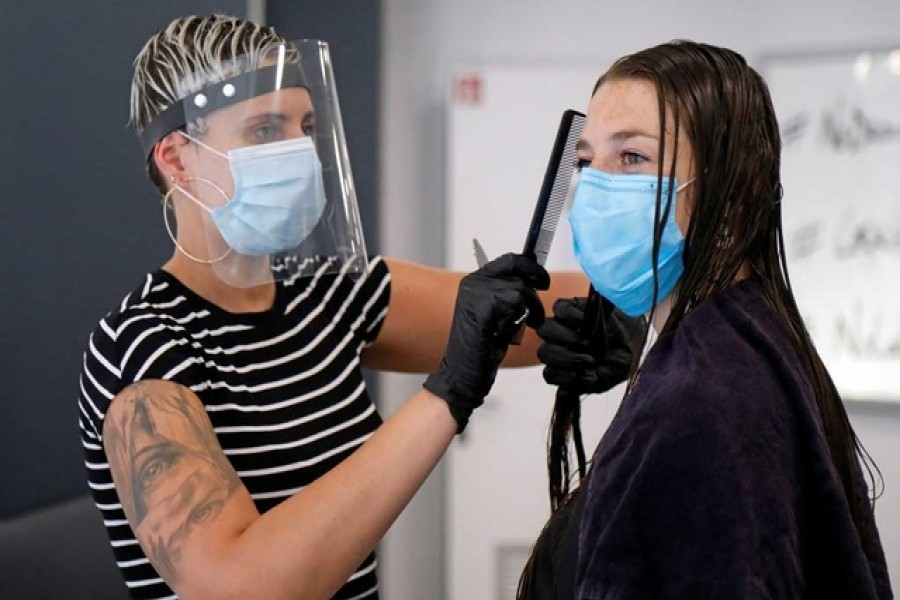 Hairdressers test on each other new anti-coronavirus measures in Ludovic Geheniaux Paris hair salon, before its re-opening, during the outbreak of the coronavirus disease (COVID-19), in Paris, France, May 9, 2020. Reuters