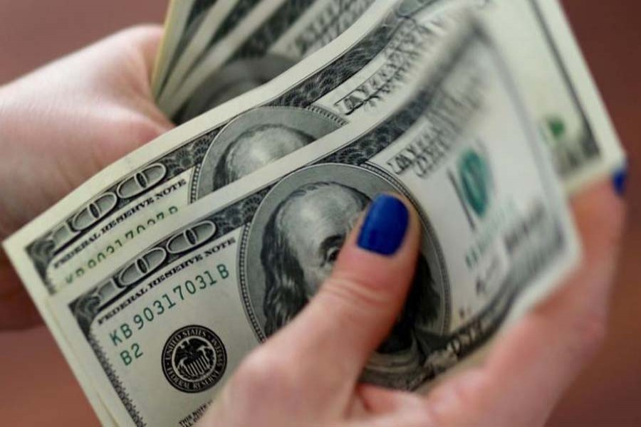 Dollar dips as virus recovery optimism holds