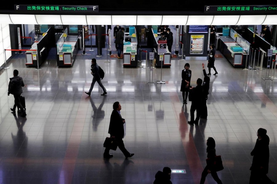 Passengers are seen in front of security check at the Tokyo International Airport, commonly known as Haneda Airport, in Tokyo, Japan on January 10, 2018 — Reuters/Files