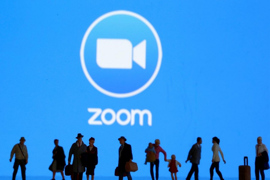 Small toy figures are seen in front of diplayed Zoom logo in this illustration taken on March 19, 2020 — Reuters/Files