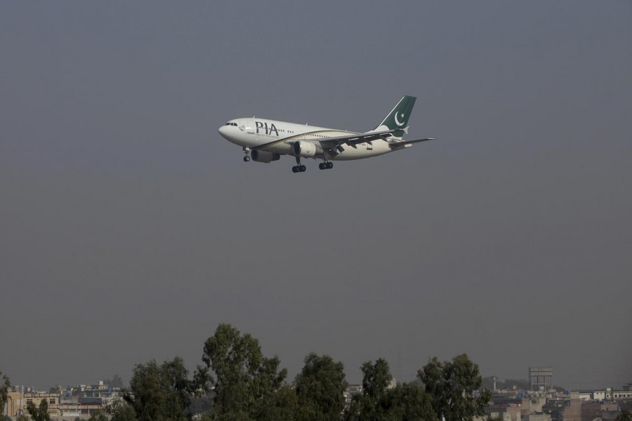 A Pakistan International Airlines (PIA) passenger plane arrives at the Benazir International airport in Islamabad, Pakistan, December 2, 2015. REUTERS/Faisal Mahmood/Files
