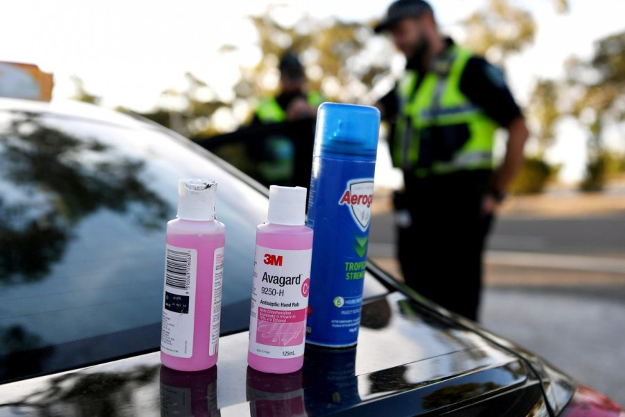 Disinfectant products are seen on a car whilst motorists fill out paperwork for police as they cross back into South Australia from Victoria during the coronavirus disease (Covid-19) outbreak, in Bordertown, Australia on March 24, 2020 — Reuters/Files
