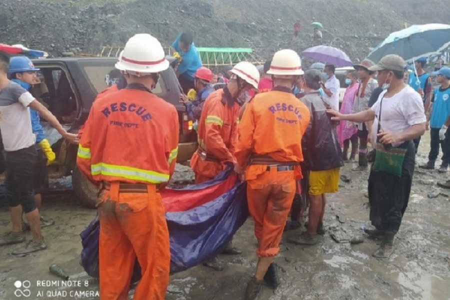 Rescue workers carry a dead body following a landslide at a mining site in Hpakant, Kachin State City, Myanmar, July 02, 2020, in this picture obtained from social media — Myanmar Fire Services Department/via Reuters/File Photo