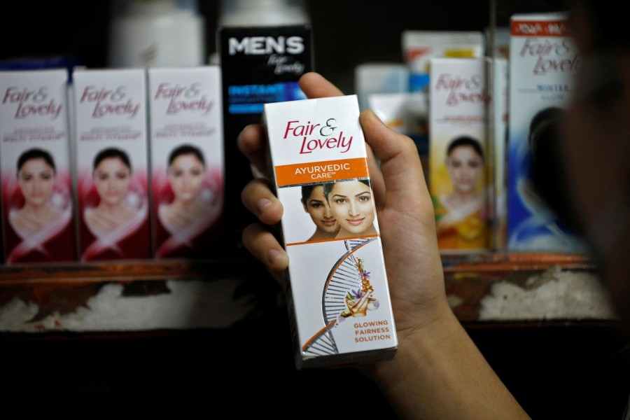 """A customer picks up """"Fair & Lovely"""" brand of skin lightening product from a shelf in a shop in Ahmedabad, India on June 25, 2020 — Reuters/Files"""