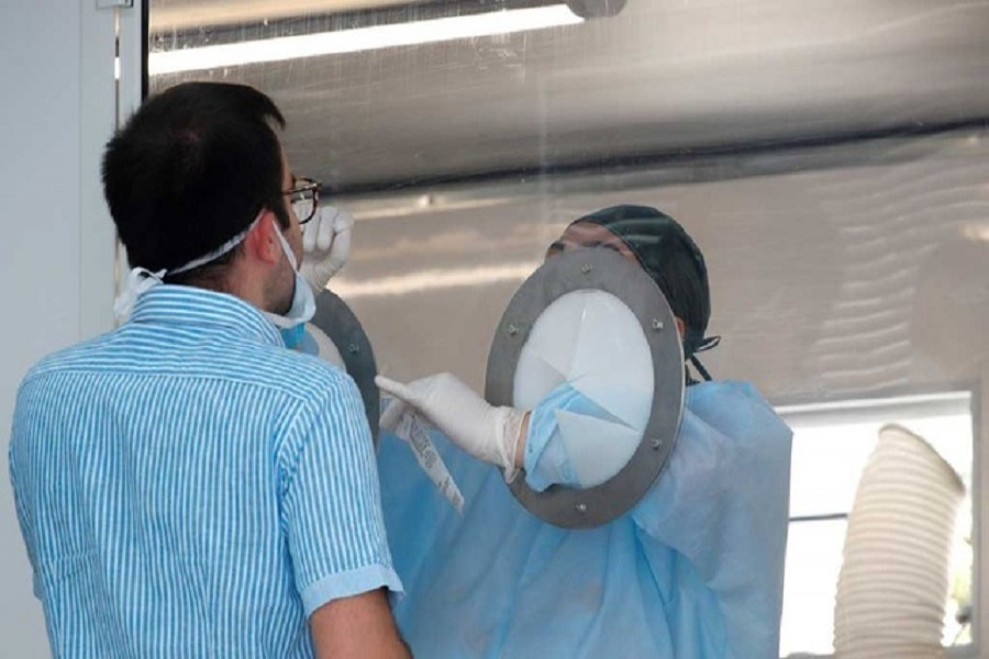 A Mondragone citizen is tested for the coronavirus disease (Covid-19) after 49 people tested positive at a residential complex that was cordoned off after it was placed under quarantine, in the village of Mondragone, northwest of Naples, Italy, June 26, 2020 — Reuters