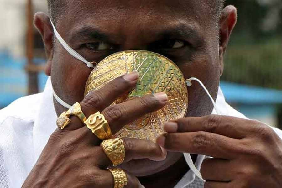 Shankar Kurhade posing a photograph with his face mask made out of gold as he poses for amidst the spread of the coronavirus disease (COVID-19) in Pune on Saturday –Reuters Photo