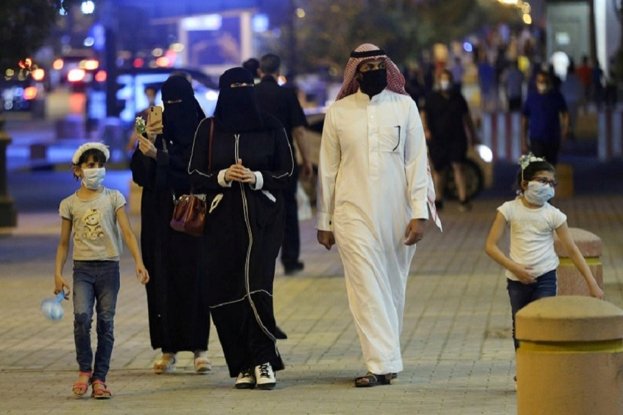A Saudi family wearing protective face masks walk on Tahlia Street as nightlife kicks off, after the government loosened lockdown restrictions following the outbreak of the coronavirus disease (Covid-19), in Riyadh, Saudi Arabia, June 21, 2020 — Reuters