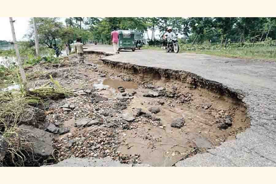 The Sunamganj-Biswambharpur road was washed away at places by the last week's floods — FE Photo