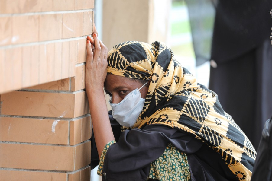 A woman with Covid-19 symptoms cuts a dejected figure outside Mugda General Hospital as she gets tired of waiting for coronavirus test  — File photo