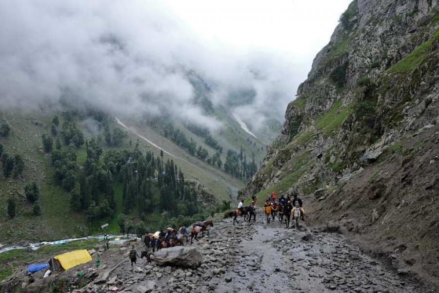 Hindu pilgrims trek through mountains to reach the holy Amarnath cave shrine, where they worship an ice stalagmite that Hindus believe to be the symbol of Lord Shiva, near Pahalgam in the Kashmir region, July 27, 2019. REUTERS/Alasdair Pal