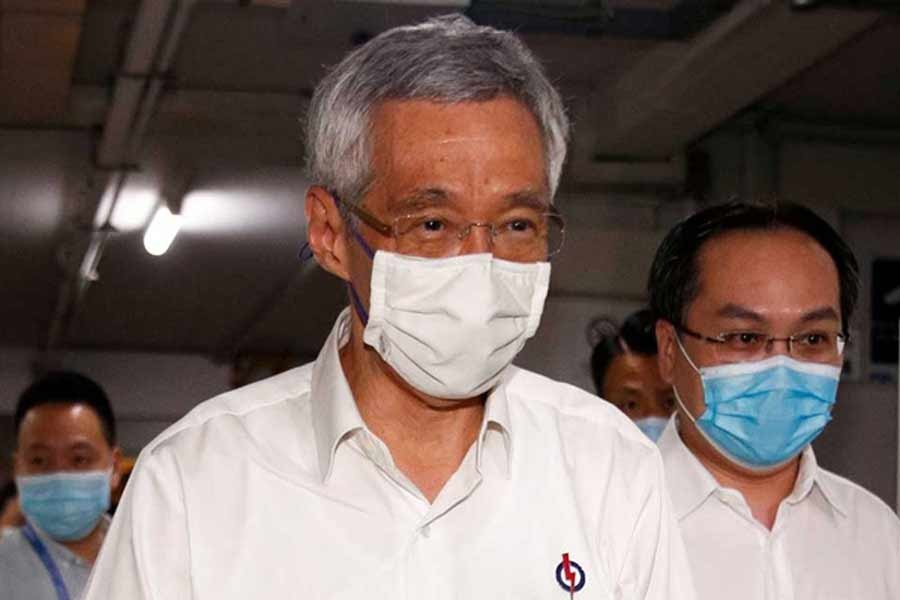 Singapore PM flags delay of step down plan over virus