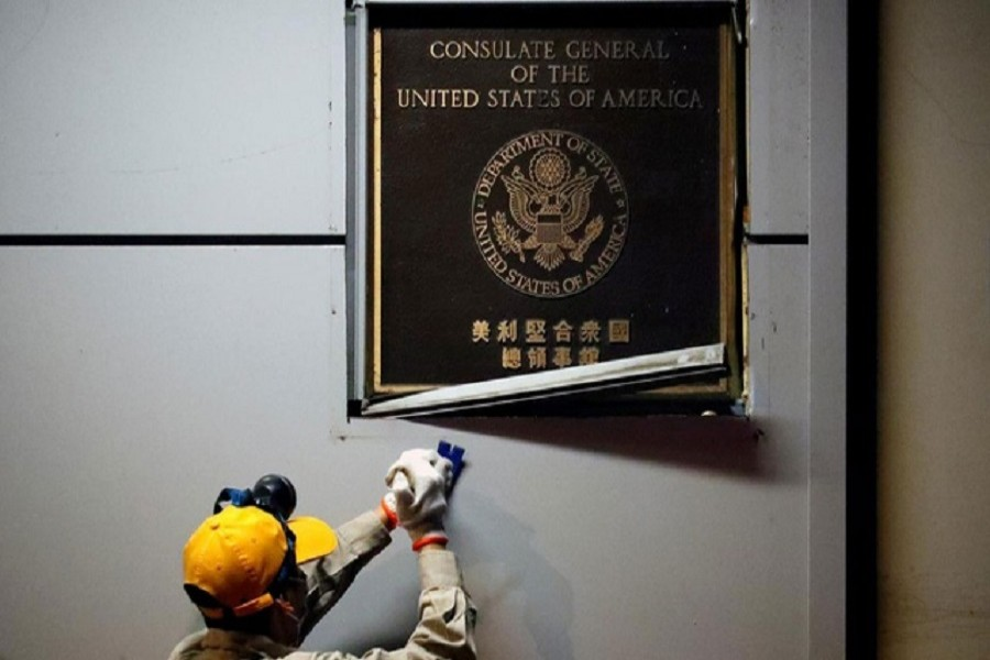 A man works to remove the US Consulate plaque at the US Consulate General in Chengdu, Sichuan province, China, July 26, 2020 — Reuters