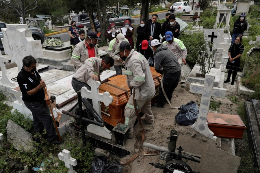 Cemetery workers move the coffin of a man, who died of the coronavirus disease (Covid-19), during his funeral at the San Nicolas Tolentino cemetery in the Iztapalapa neighbourhood in Mexico City, Mexico on August 4, 2020 — Reuters photo