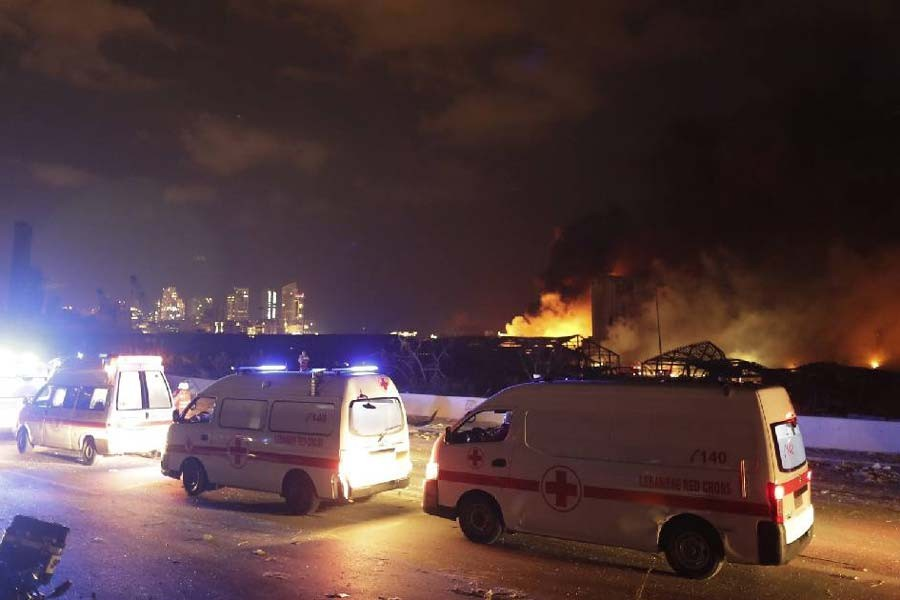 Ambulances driving past the site of a massive explosion in Beirut, Lebanon's capital, on Tuesday –AP Photo