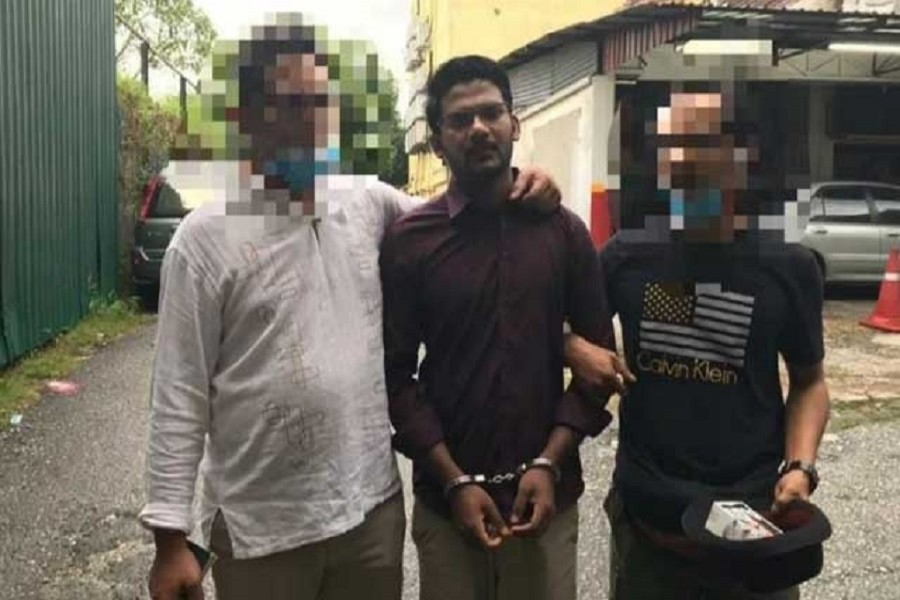 Malaysia's Immigration Department arrested Bangladeshi national Md Rayhan Kabir on July 24 last — Picture via Facebook/Immigration Department/Malay Mail