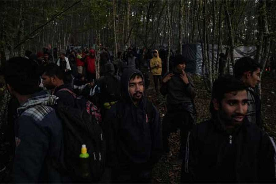 "Hundreds of migrants from Asia, the Middle East and North Africa gathering before trying to cross the Bosnia-Croatia border what they call ""the game"", in the woods near Velika Kladusa on Wednesday –Reuters Photo"
