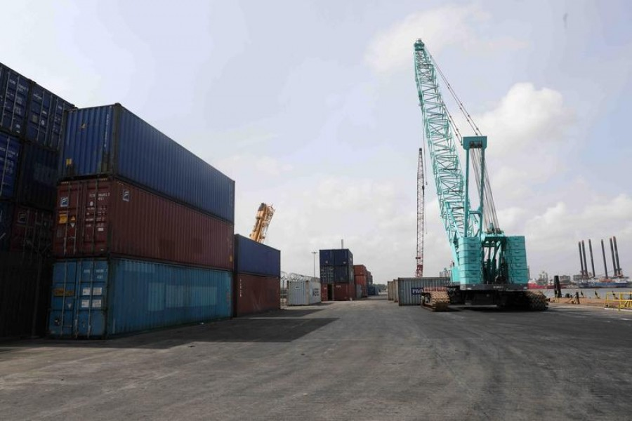 FILE PHOTO: Cranes and containers seen at APM Terminals on the gateway port in Apapa, Lagos, Nigeria July 30, 2019. REUTERS/Temilade Adelaja