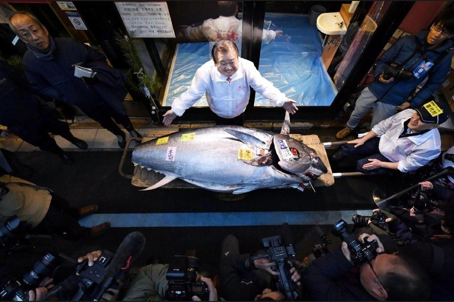 Kiyoshi Kimura, president of Kiyomura Corp., operator of Japanese sushi chain Sushizanmai, poses with a bluefin tuna that was auctioned for 193 million Japanese yen (about $1.8 million) in Tokyo, Japan January 5, 2020. Mandatory credit Kyodo