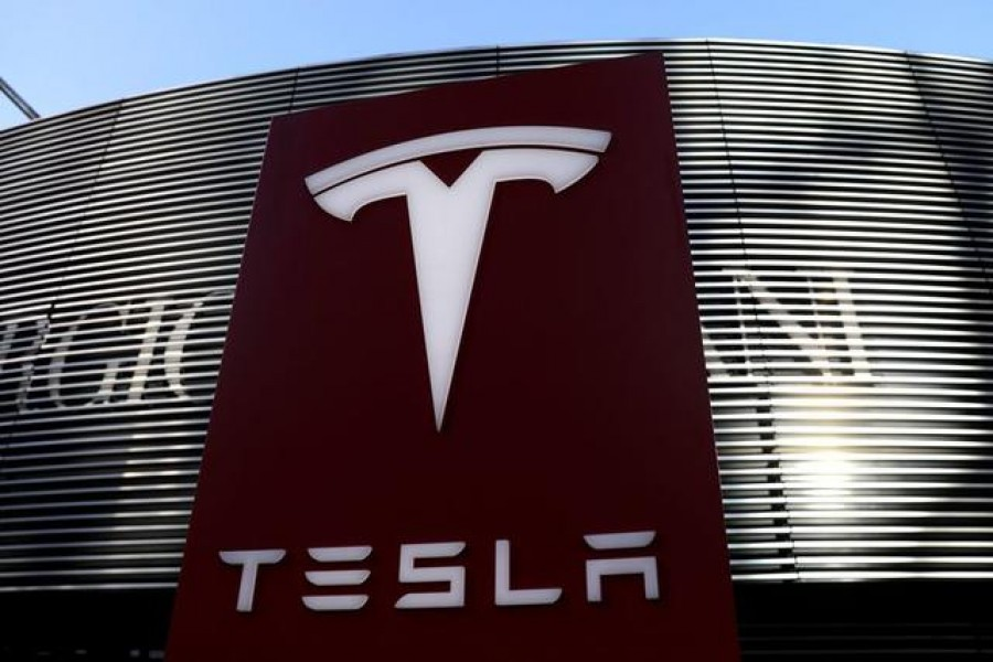A logo of electric vehicle maker Tesla is seen near a shopping complex in Beijing, China on January 5, 2021 — Reuters/Files