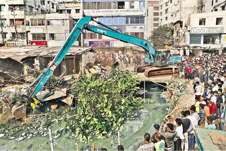 Dhaka North City Corporation knocks down illegal structures on the bank of Ibrahimpur canal at Mirpur in the city during a drive against encroachers recently— FE file photo