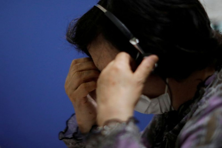 A volunteer responds an incoming call at the Tokyo Befrienders call center, a Tokyo's suicide hotline center, during the spread of the coronavirus disease (COVID-19), in Tokyo, Japan May 26, 2020. REUTERS