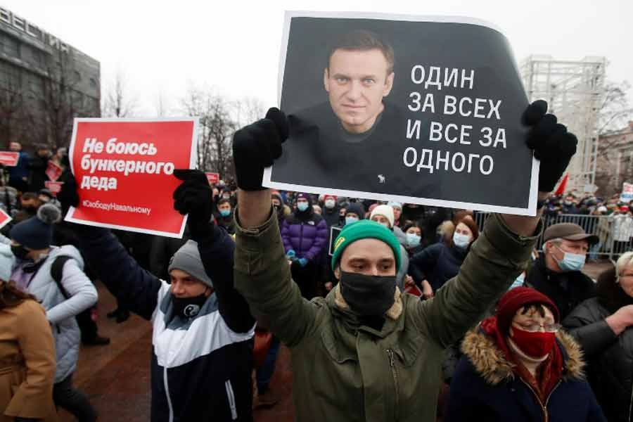 """A participant holding a placard reading """"One for all, all for one"""" during a rally in support of jailed Russian opposition leader Alexei Navalny in Moscow on Saturday –Reuters Photo"""