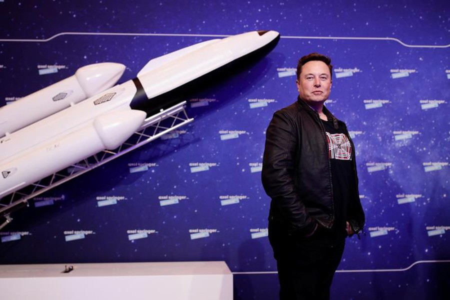 SpaceX owner and Tesla CEO Elon Musk poses after arriving on the red carpet for the Axel Springer award, in Berlin, Germany on December 1, 2020 — Pool via Reuters